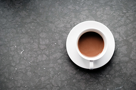 cup of tea on grey background